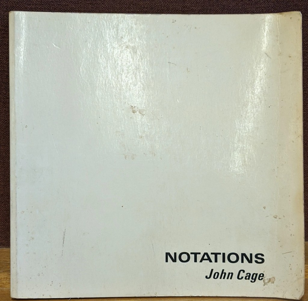 A book cover, completely white, blank, with black text that says Notations John Cage