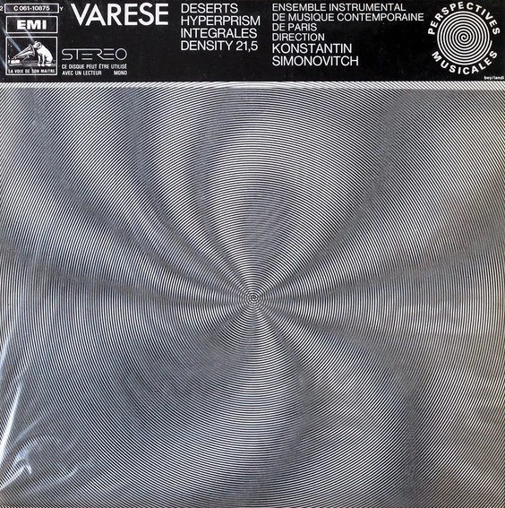 A vinyl record sleeve, in black and white, with an abstract spiral image across the front, and a band of black across the top with the titles for the pieces of music.