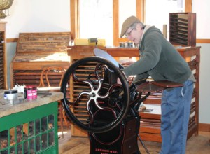 Mark Matteau using a Gold Pearl Printing Press at Willowbrook.