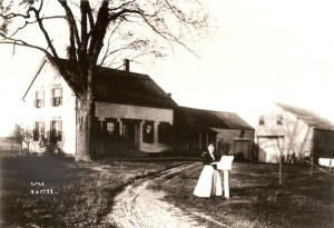 Photo of Mrs. Elena Peterson at her mailbox on Pleasant Hill RD, circa 1903.