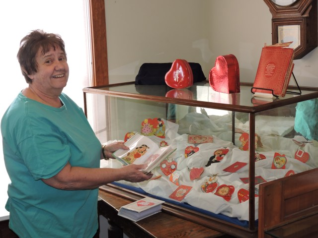 Photo of Curator Becky Delaware with the Valentine 2019 display.