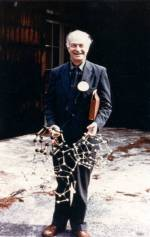 Linus Pauling holding models of the structure of water. 1960s.