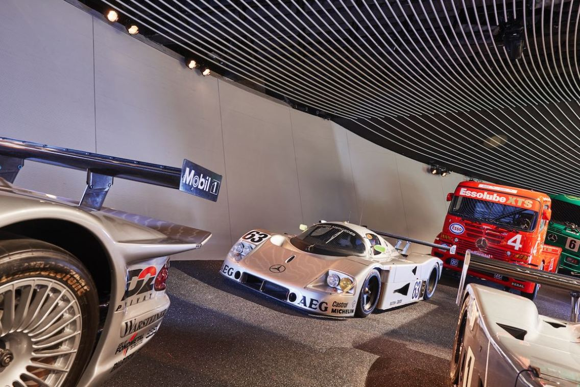 "The Le Mans 1989 winning car: Sauber-Mercedes C 9 sports car prototype with start number 63 in the high-bank curve in the Mercedes-Benz Museum, room ""Legend 7: Silver Arrows – Races and Records"" exhibition area. The drivers were Stanley Dickens, Jochen Mass and Manuel Reuter."