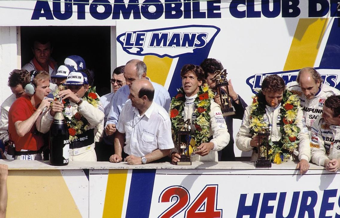 Double victory and fifth place. Champagne shower: the victors celebrating. Winners: Jochen Mass / Manuel Reuter / Stanley Dickens. Driver team Mauro Baldi / Kenny Acheson / Gianfranco Brancatelli finish second. The team made up by Jean-Louis Schlesser / Jean-Pierre Jabouille / Alain Cudini finish fifth. Peter Sauber at centre.