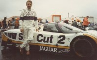 Andy Wallace stands proudly beside his 1988 Le Mans-winning XJR-9