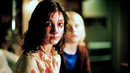Lina Leanderssson (Eli) and Kåre Hedebrant (Oskar), in Let the Right Ones In (2008)