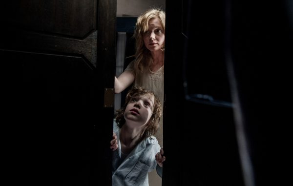 Anything in the closet? Essie Davis and Noah Wiseman look for monsters in The Babadook (2014)