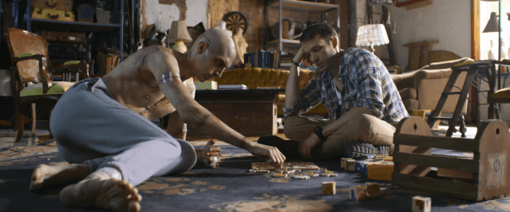 Adam (Alex Breaux) and Henry (David Call) try to retrain Adam's brain with wooden kids puzzles in Depraved (2019)