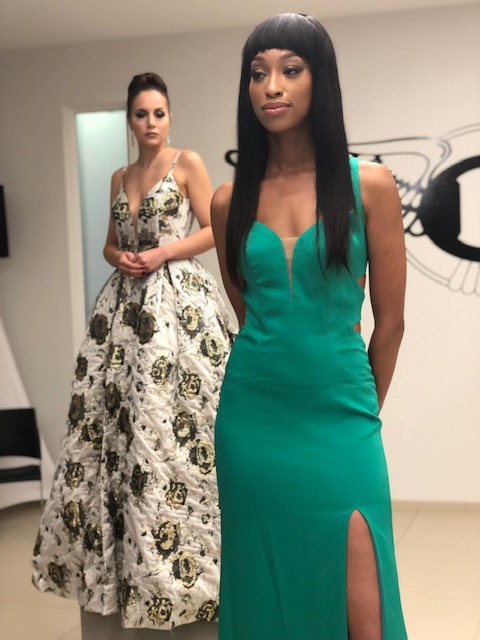 model wearing teal dress at Bentley Atlanta