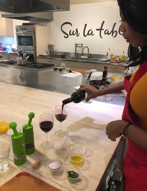 pouring wine at Sur La Table