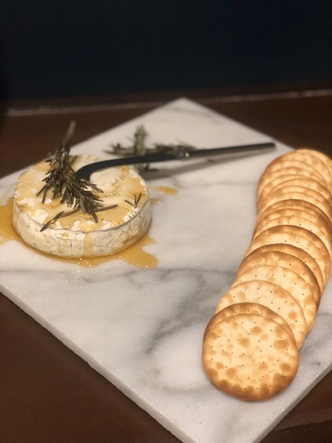 vision board party appetizers on marble board