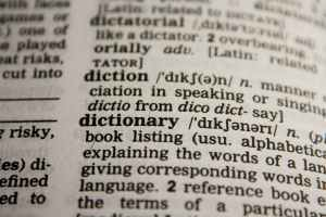 close up picture of dictionary with definitions