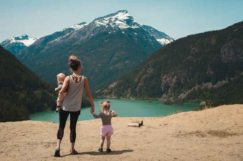mother with her two children looking at a mountain
