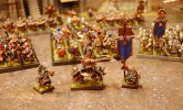 The Dwarf army is led by a stout Dwarf Lord on Shieldbearers, a Thane BSB, and a mysterious Runepriest