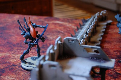 The Wraithlord also deploys behind cover.