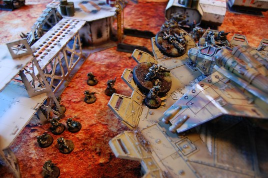 The infantry squad and the 2IC leave the safety of the guard tower and advance ahead to reinforce the Elysian positions around the first objective marker on the landing pad. Using the order 'Get back into the fight!' Cpt. Perseus orders the heavy weapons to open fire on the Spiritseer after disengaging. All shots fail to hit however.