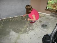 My daughter, Miss M. was helping me scrub off all of the drywall mud.