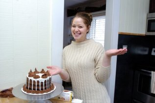 Courtney Hubbard works on a cake in her kitchen in Hampton Bays. DANA SHAW
