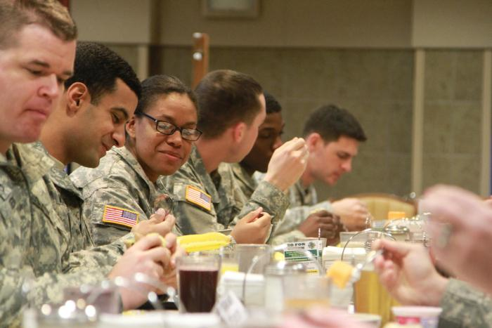 Spc. Yousef Muthana, an explosive ordnance disposal specialist, and Spc. Antigone Lowery a supply specialist, both with the 752nd Explosive Ordnance Disposal, share a meal during the prayer breakfast at the Operation Iraqi Freedom Dining Facility on Feb.