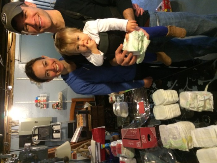 Claire, Brad, and Libby wrapping a seemingly endless supply of newborn diapers.
