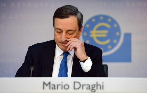 President of the European Central Bank (ECB) Mario Draghi attends a press conference in Frankfurt am Main, on June 5, 2014. The ECB said in a statement that it is lowering all three of its key interest rates, which have been on hold at record lows all this year. AFP PHOTO / DPA/ ARNE DEDERT GERMANY OUT (Photo credit should read ARNE DEDERT/AFP/Getty Images)