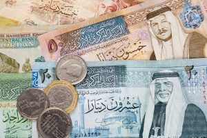 Jordanian dinar banknotes and coins background