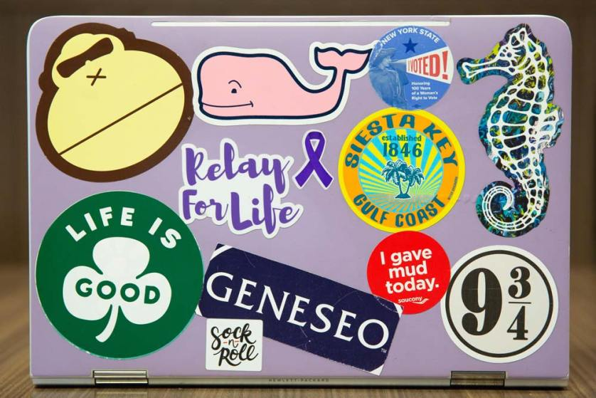 Stickers for Relay for Life, a seahorse, Geneseo and others are on a laptop.