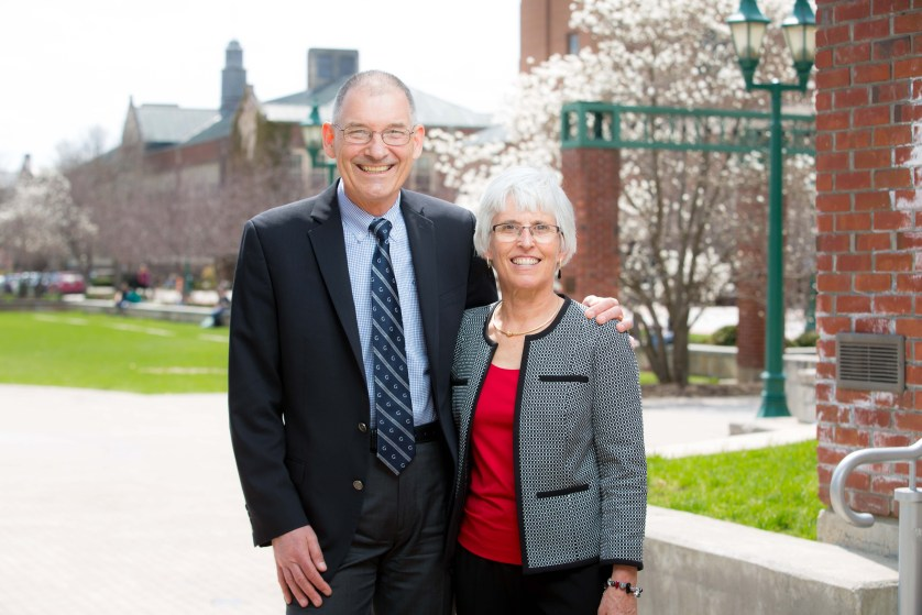 Jack and Carol Kramer stand on the College Green.