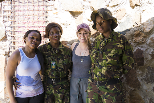 Tara Keir stands with a female anti-poaching unit