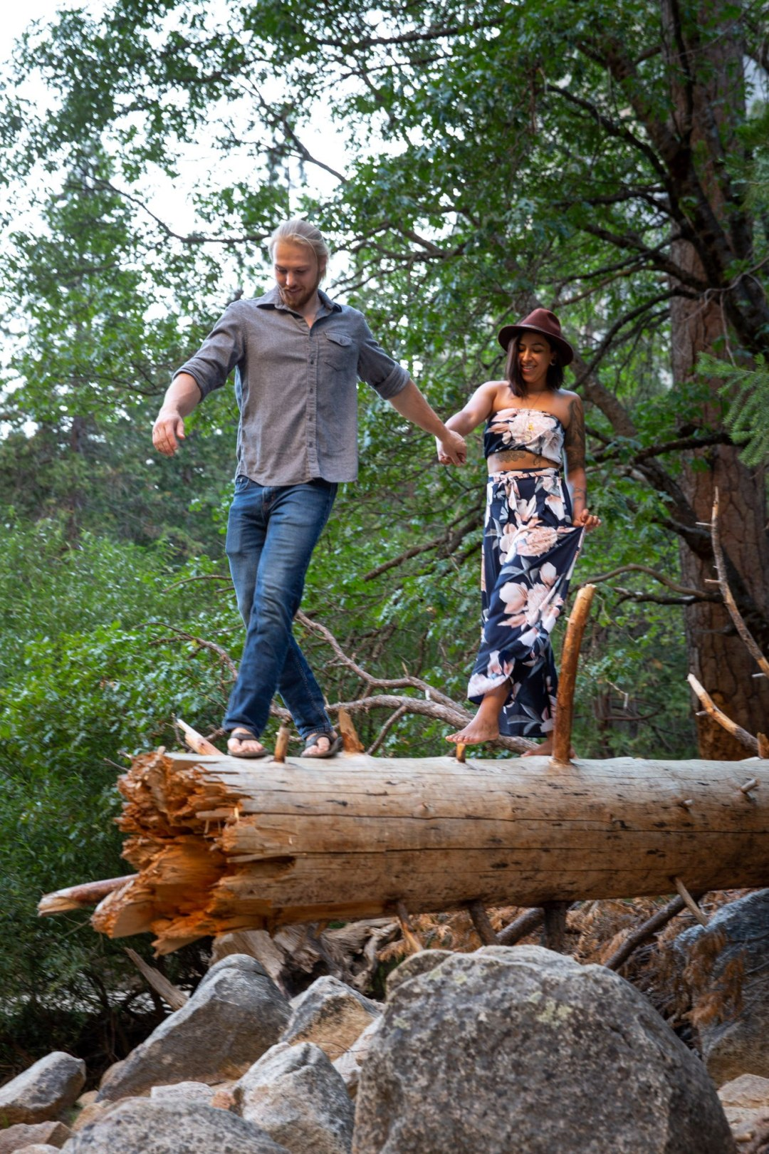 Jon & Tori walking out on a fallen tree during an adventure session.