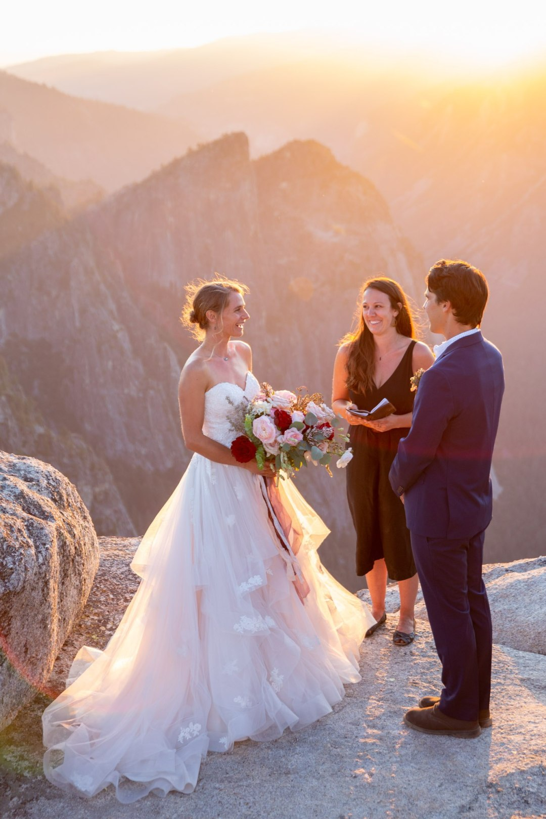 Becky officiates an adventure elopement on the edge of Taft Point in Yosemite National Park -- Yosemite Elopement