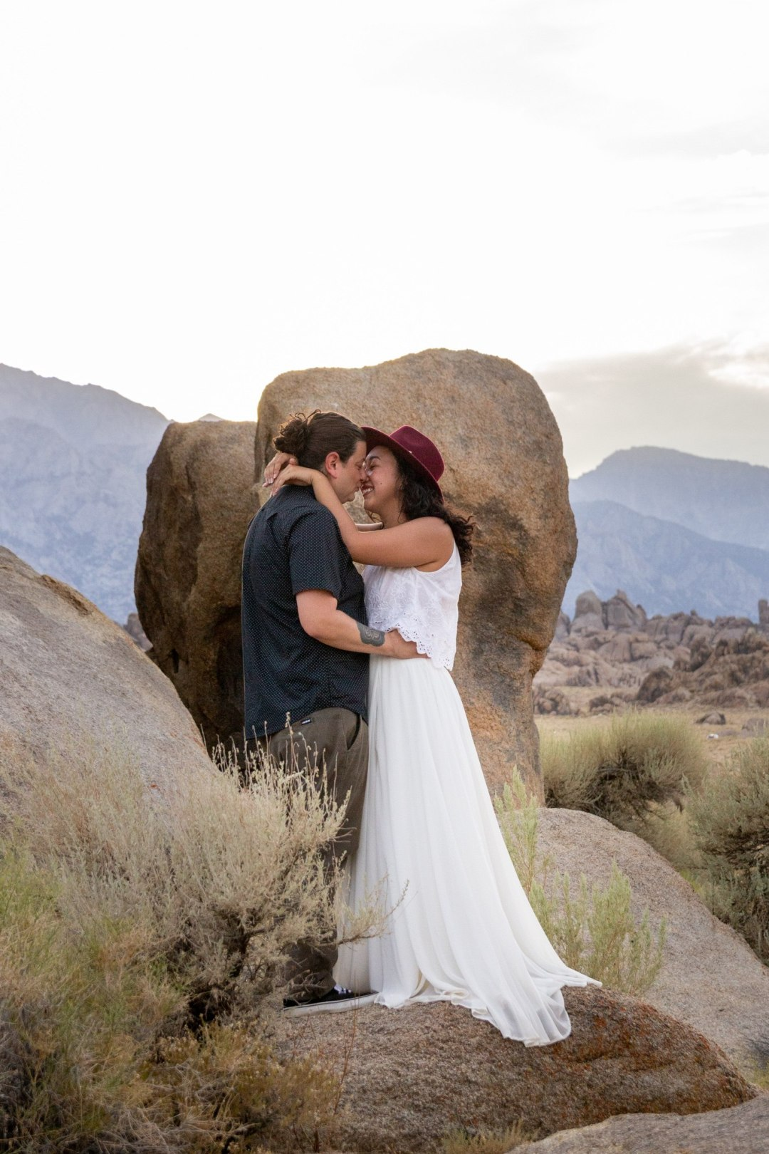 A couple almost kisses after their adventure elopement in the Alabama Hills.