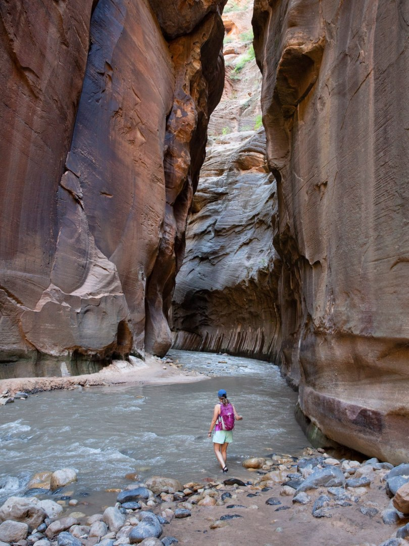 Becky explores the Narrows -- a super awesome hike in the Virgin River in Zion National Park.