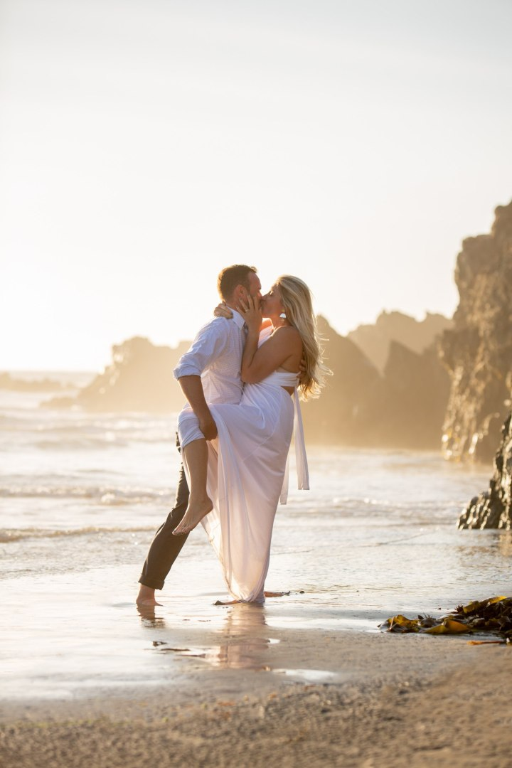 Newlyweds celebrating their sunset elopement in the golden California light.