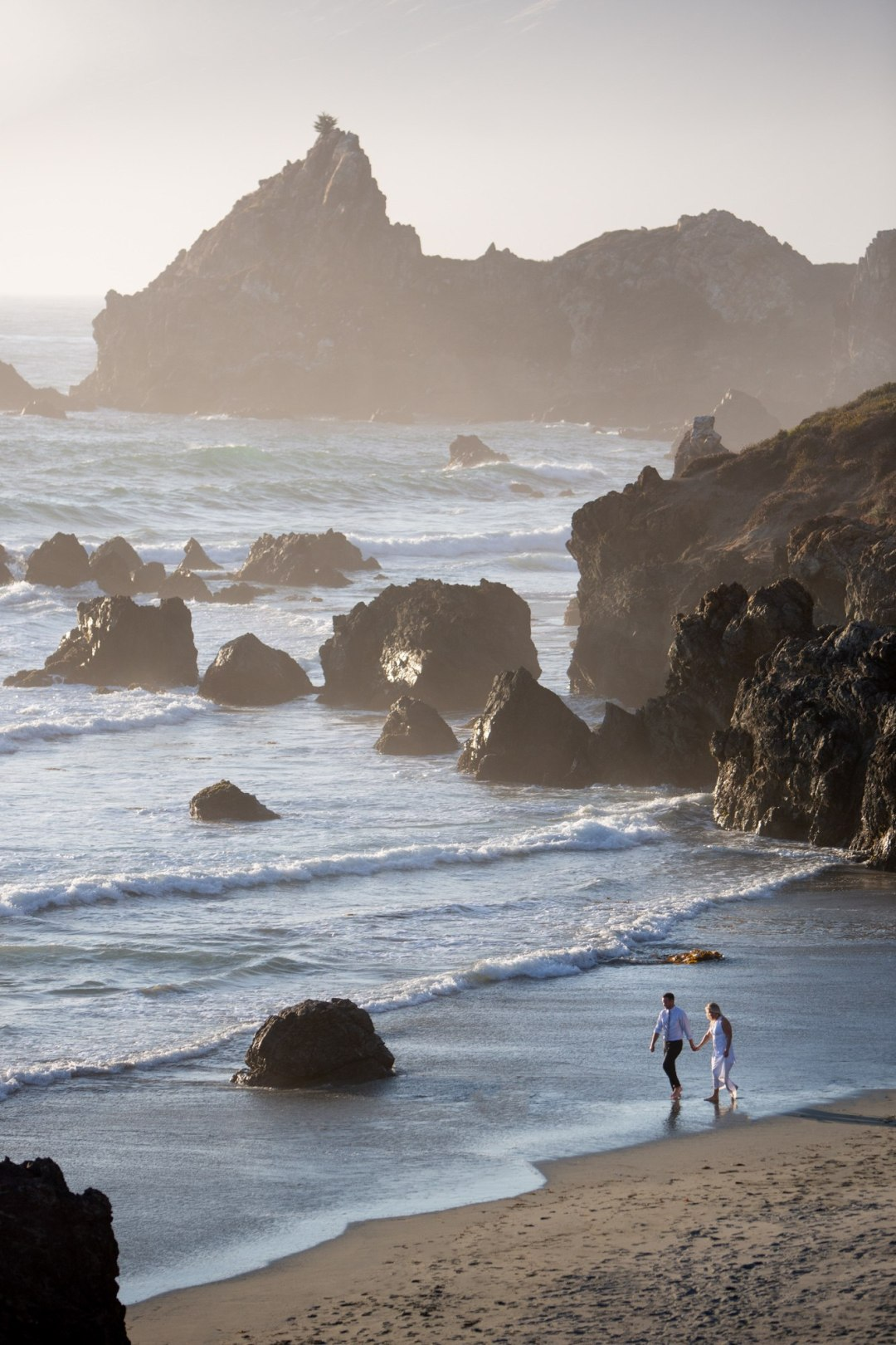 Newly weds walking on their own private beach after their amazing California elopement!
