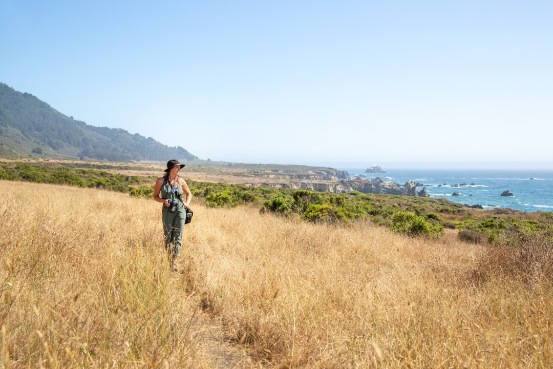 Becky standing here looking for the shot. Scouting out our locations for  an adventure elopement is our favorite!