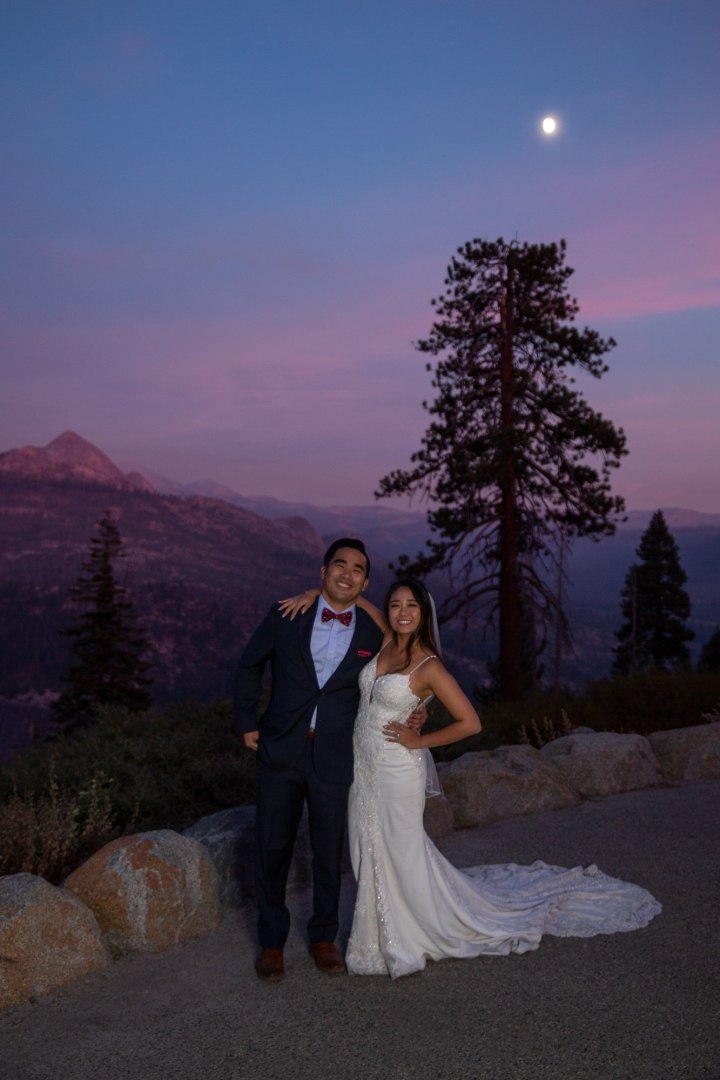 Bride and Groom pose for a photo after the first dance and under the stars in Yosemite!
