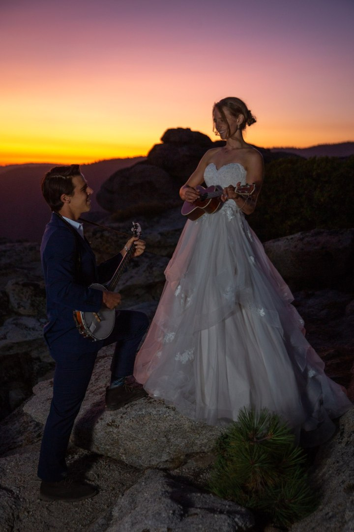 Newlyweds Alex and Sierra Wild playing some banjo and ukulele after their Yosemite adventure elopement.