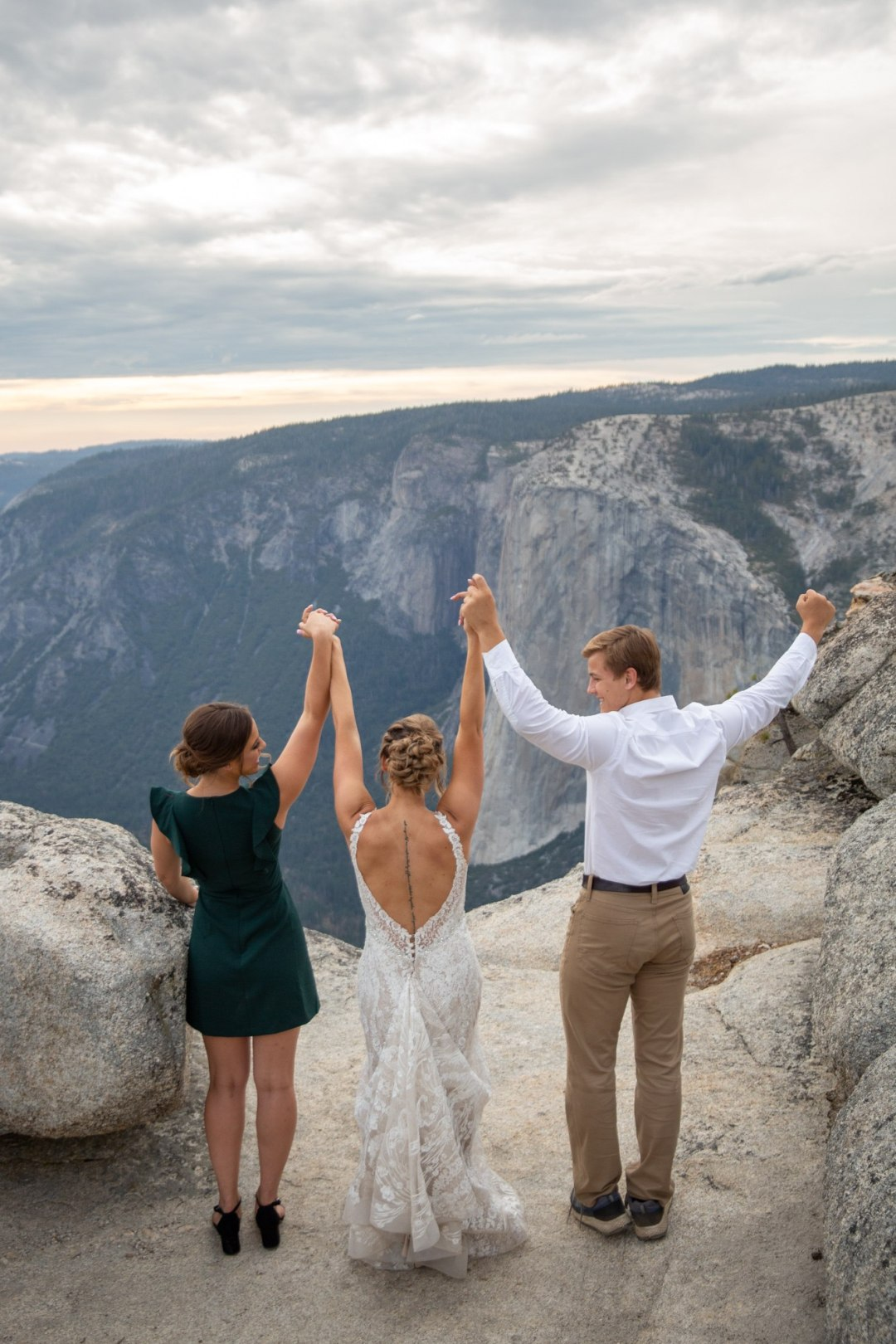 Bride cheering with her brother and sister after her Yosemite wedding