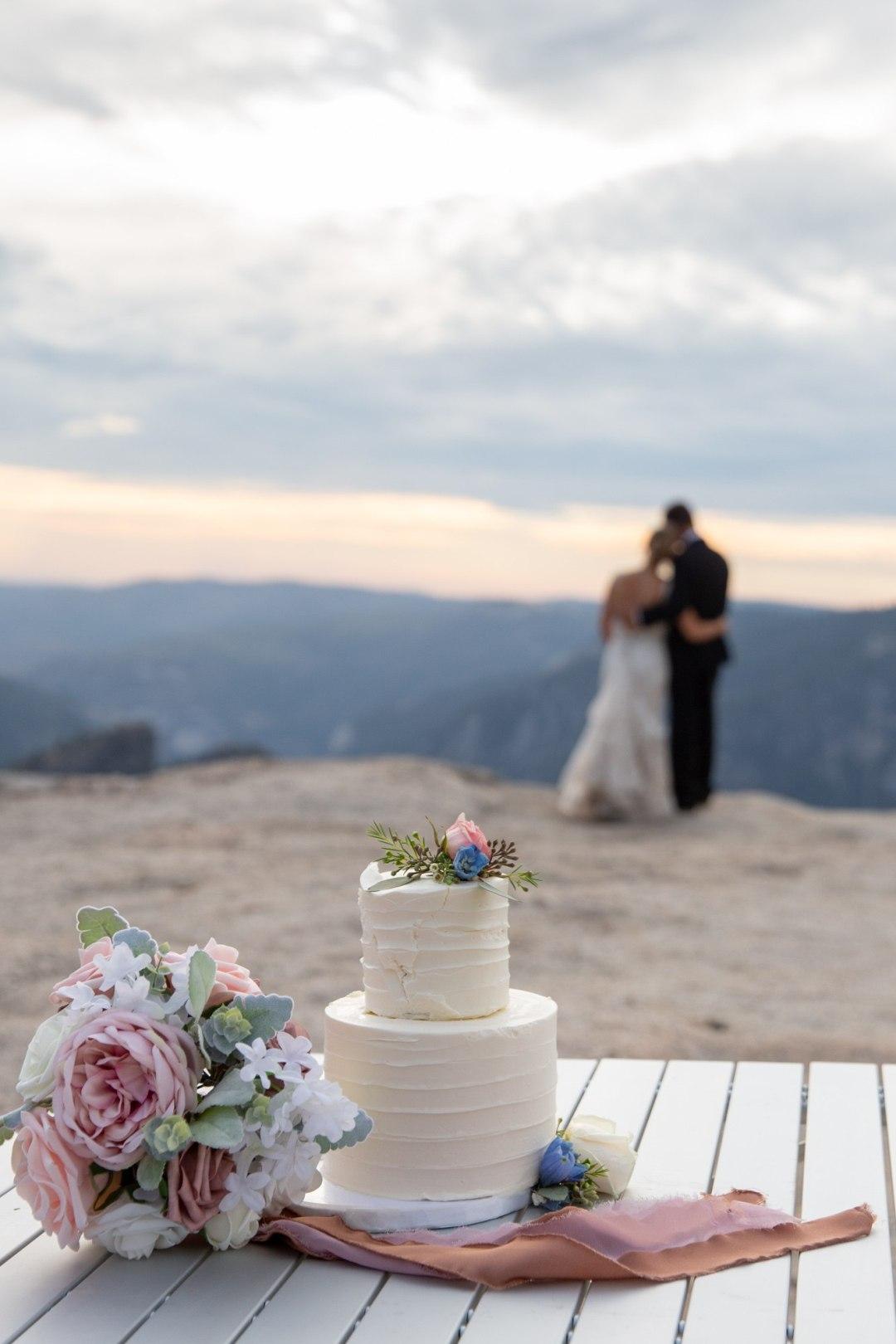 Taft Point Wedding Cake cutting during a Yosemite Intimate wedding.