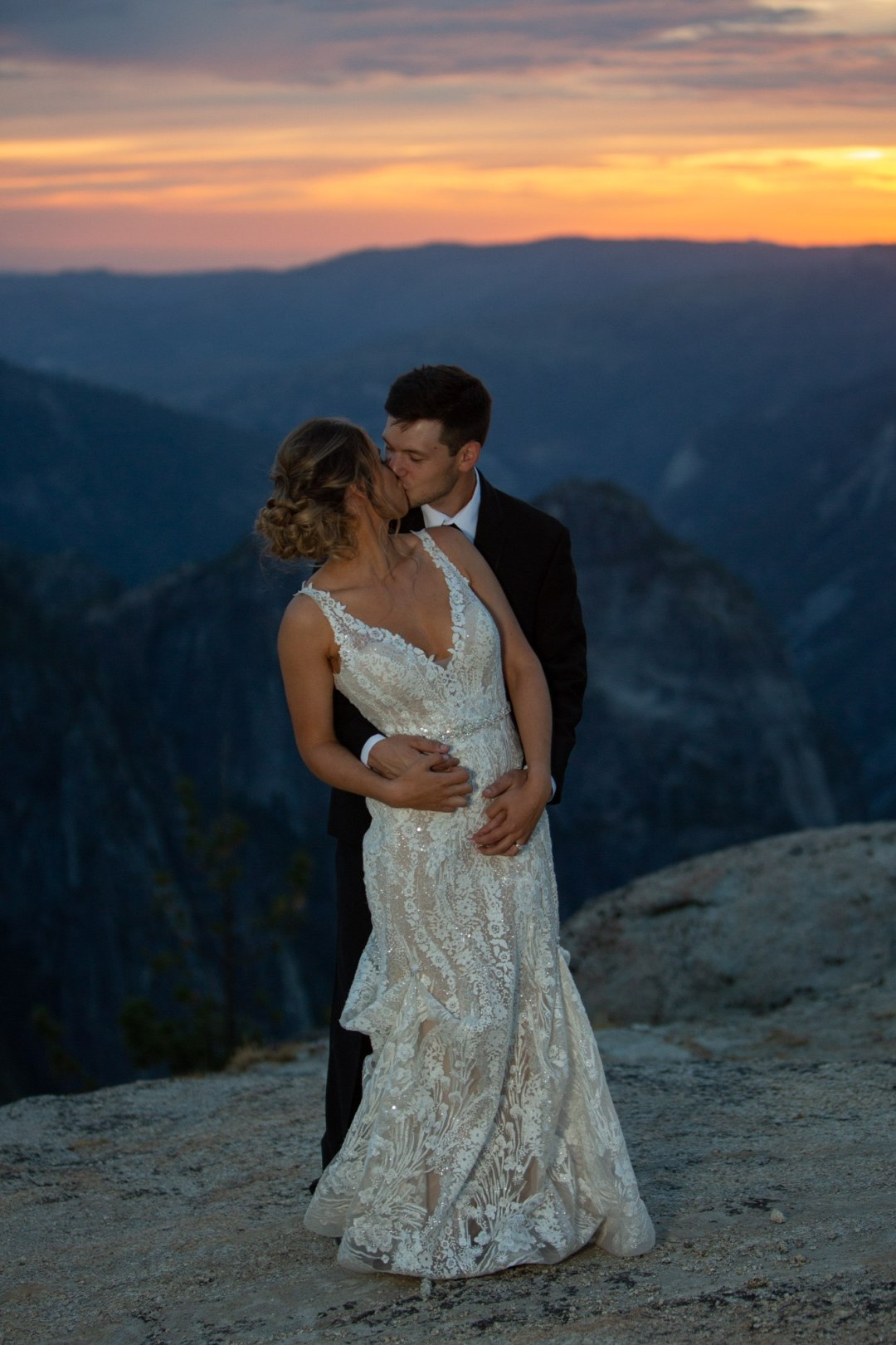 Bride and groom's first dance in the last light on Taft Point, Yosemite.