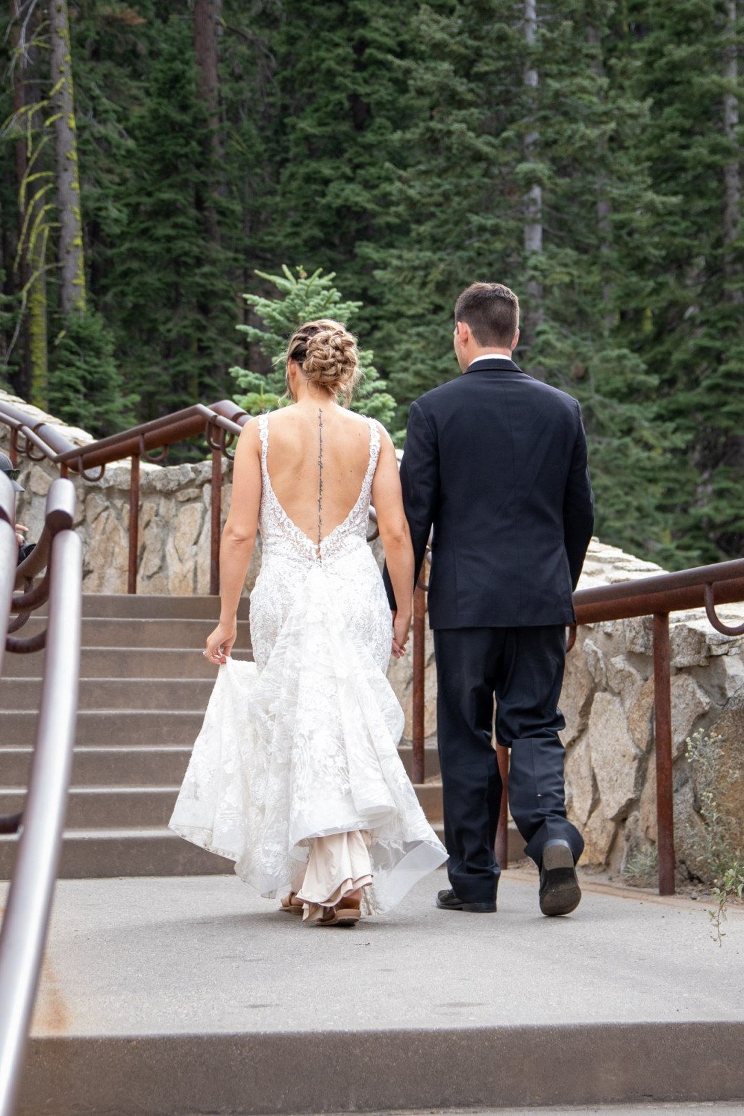 Yosemite Bride and Groom walking up the stairs at Glacier Point