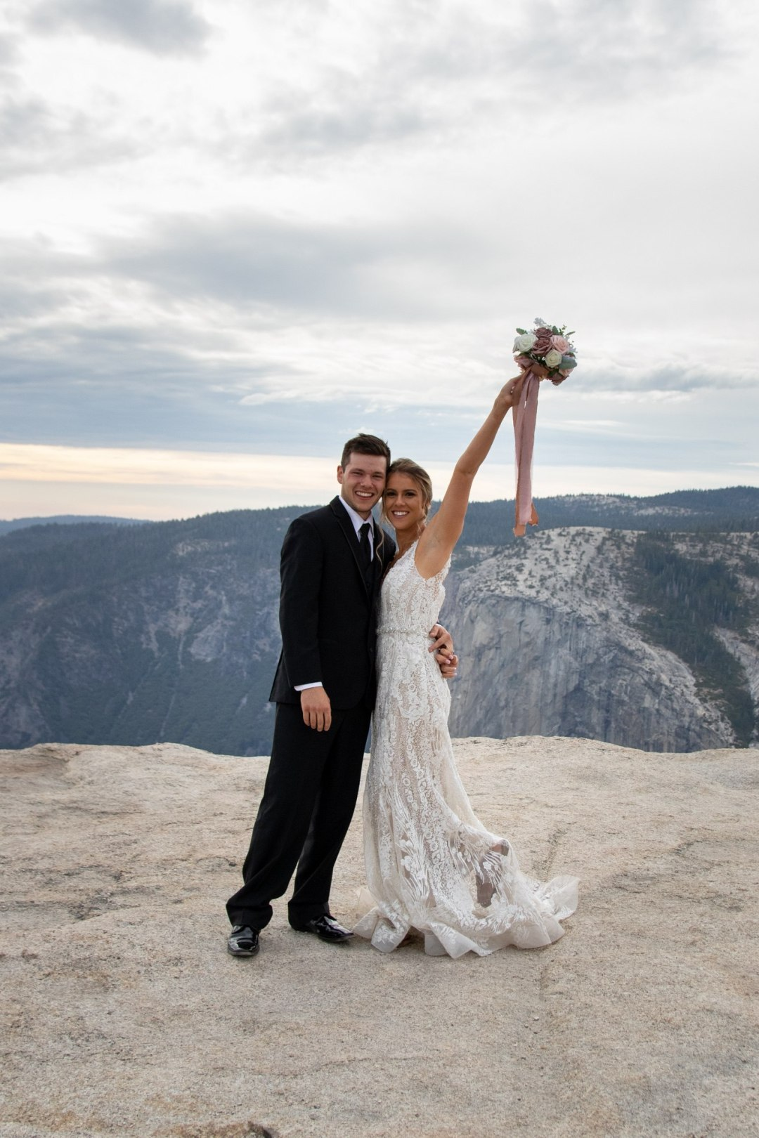 Bride and groom celebrate after Taft Point wedding ceremony.
