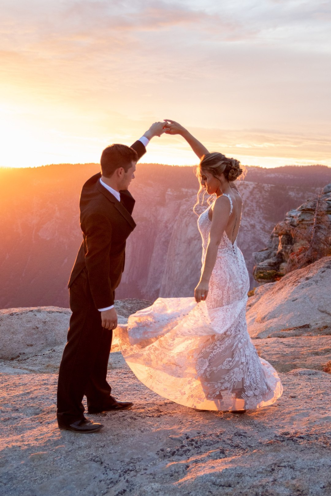 First dance in the golden sunlight after a perfect Taft Point Elopement in Yosemite.