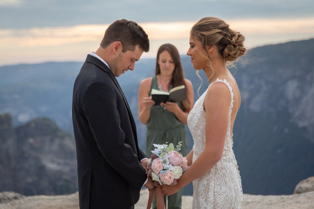 Bride and groom holding hands during Taft Point wedding ceremony