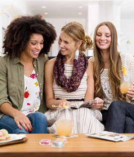 women conversing over fragrances at a Scentsy party