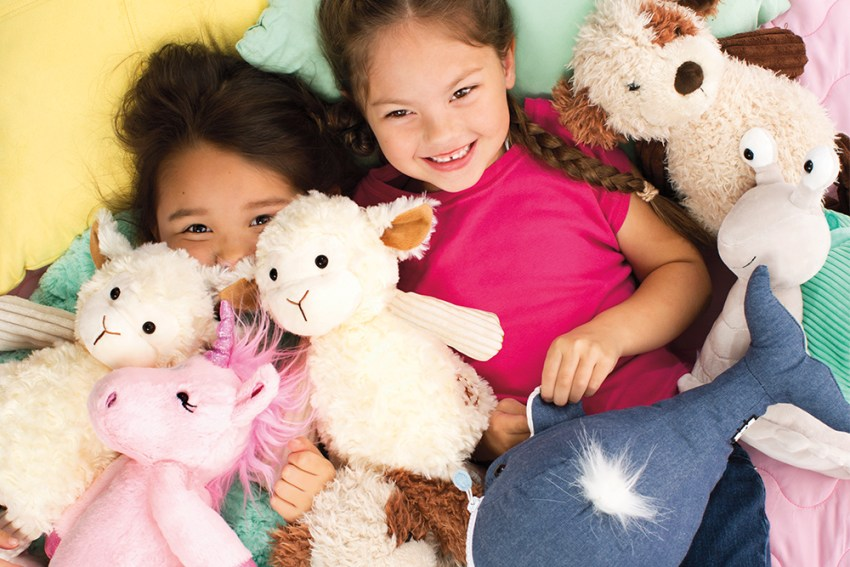 Photo of Kids in a pile of Scentsy Buddies