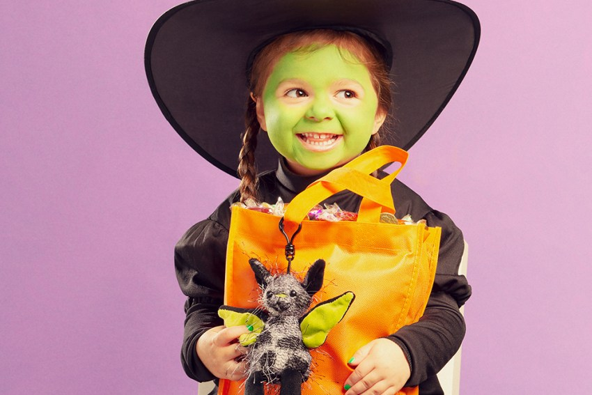 image of little girl dresse up as witch with scentsy buddy clip and trick or treat bag