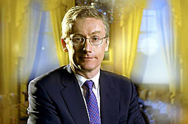 Fred Goodwin, half smile on face, stares at the camera