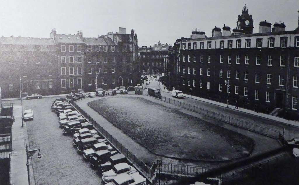 Black and white image of the old tenements around the garden of St James